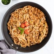 A skillet filled with low FODMAP spaghetti and zoodles.