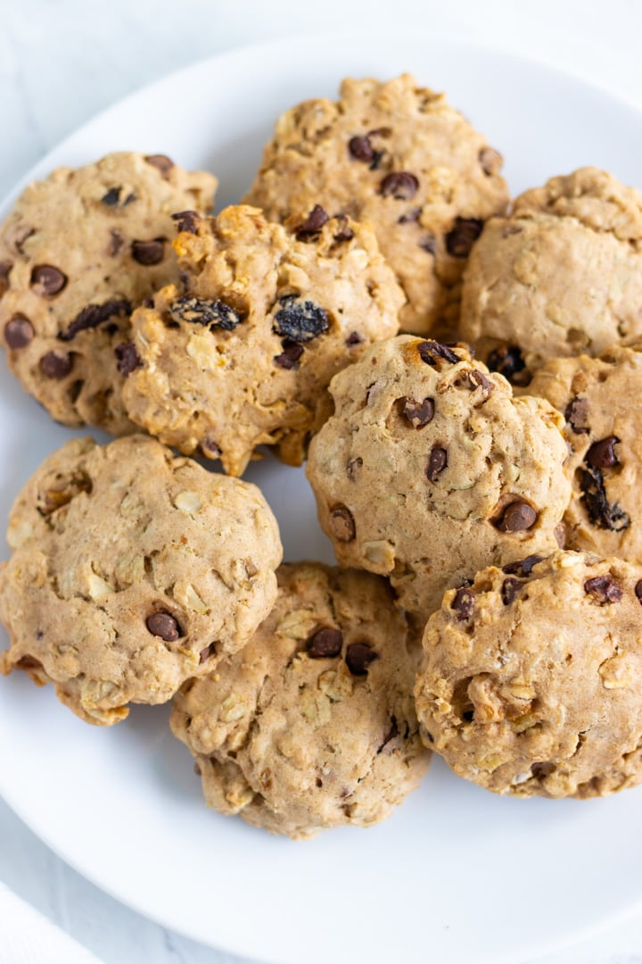 Plate of low FODMAP trail cookies with raisins, chocolate chips, and walnuts.