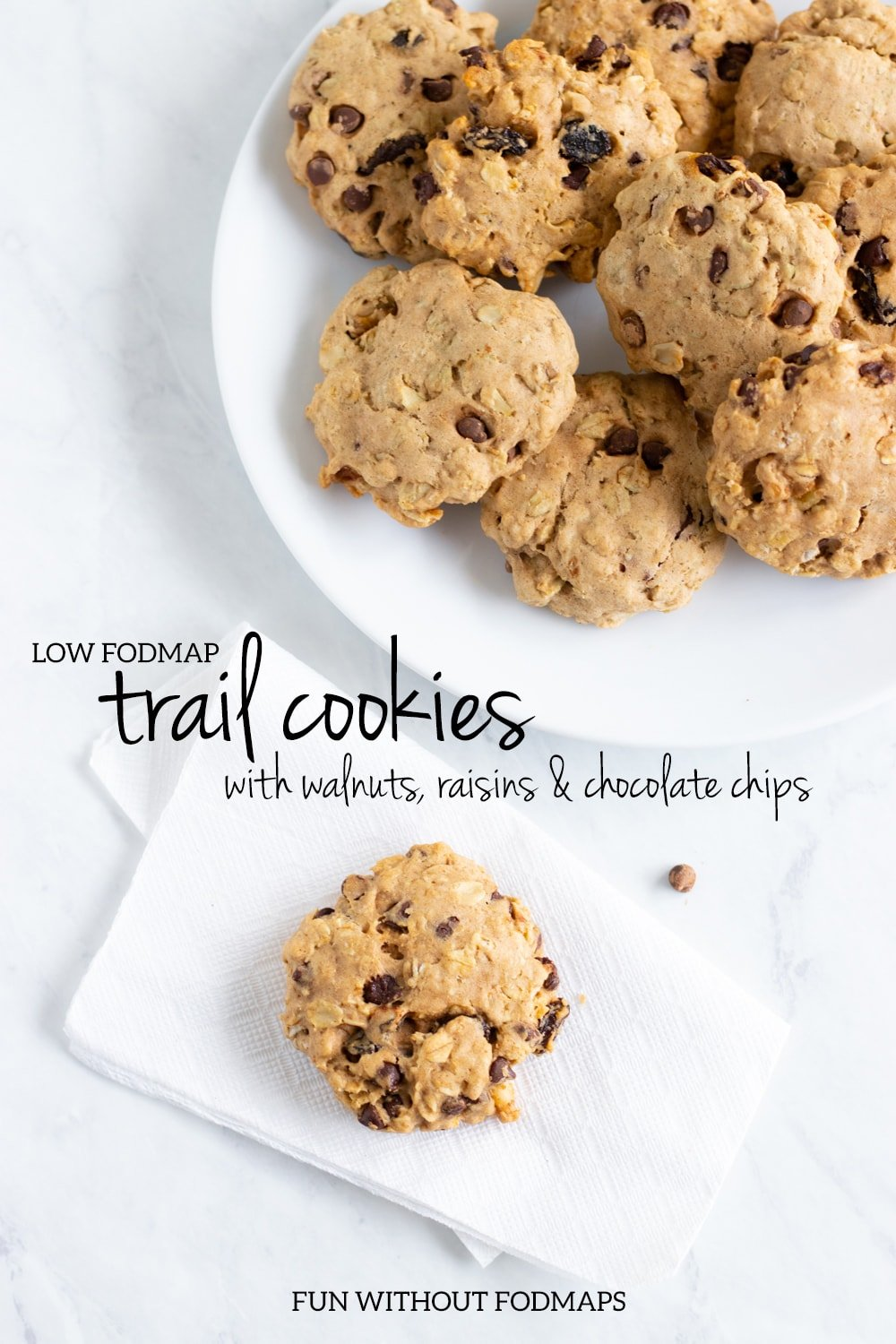 A plate with cookies in the top right and a single cookie on a white napkin in the bottom left. Black text reads low FODMAP trail cookies with walnuts, raisins, and chocolate chips.