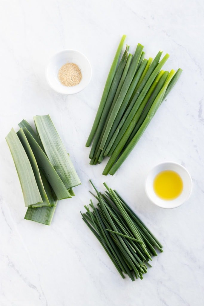 Spring onion tops, leek leaves, chives, asafoetida, and garlic-infused oil