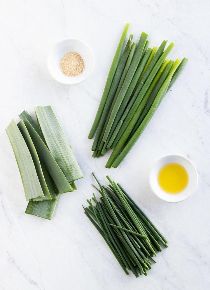 Garlic infused oil, leek leaves, chives, green onion tops, and asafoetida