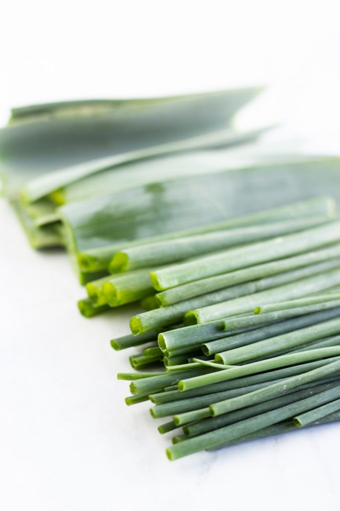 Chives, green onion tops, and leek leaves