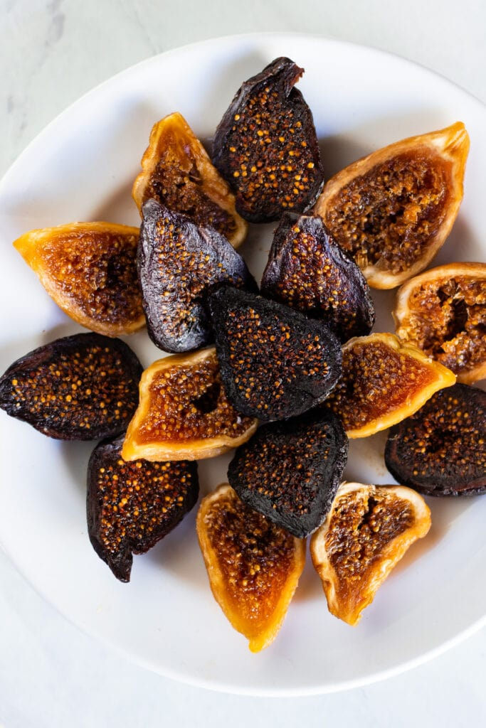a plate of dried figs cut in half lengthwise