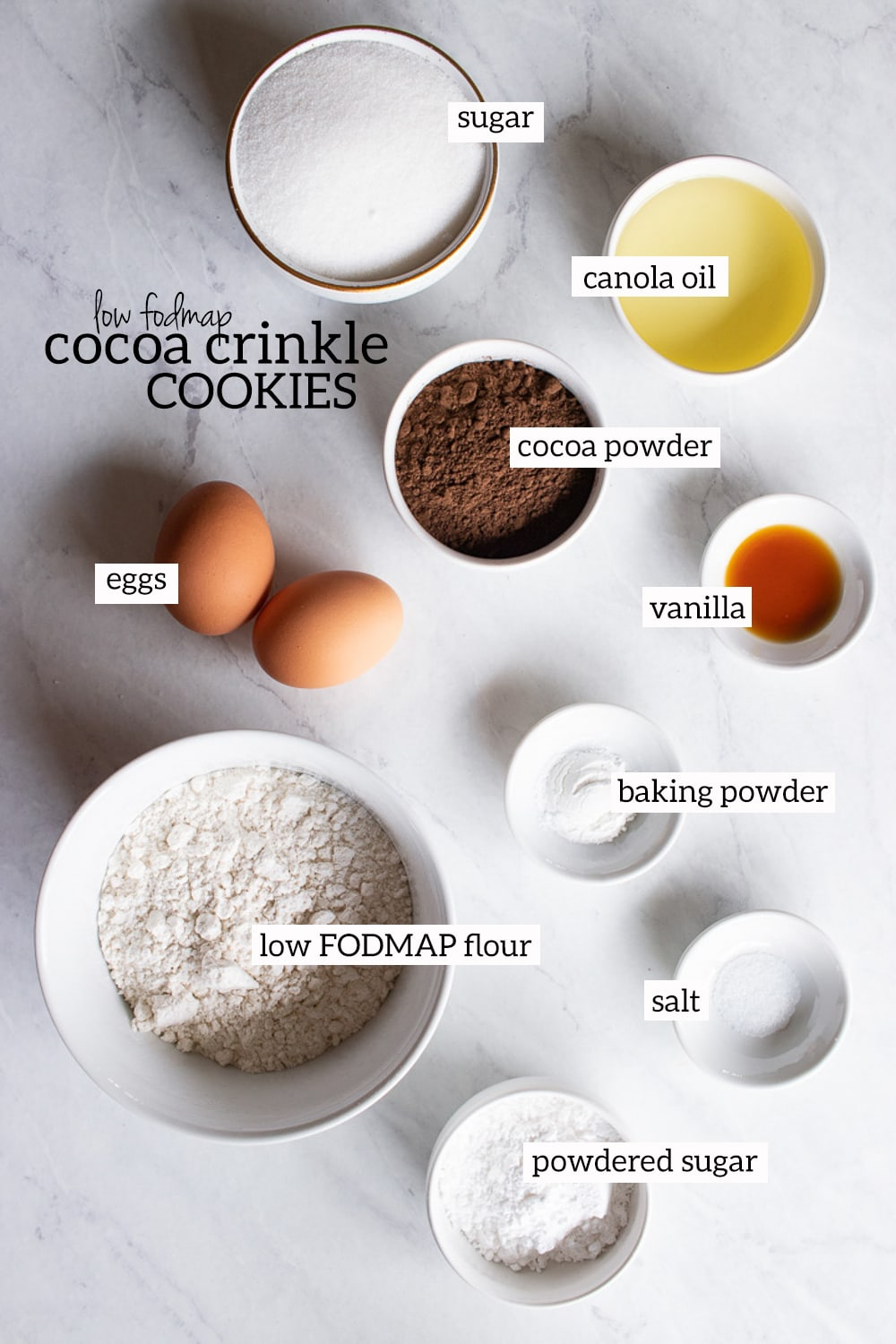 bowls of ingredients needed for cocoa crinkle cookies