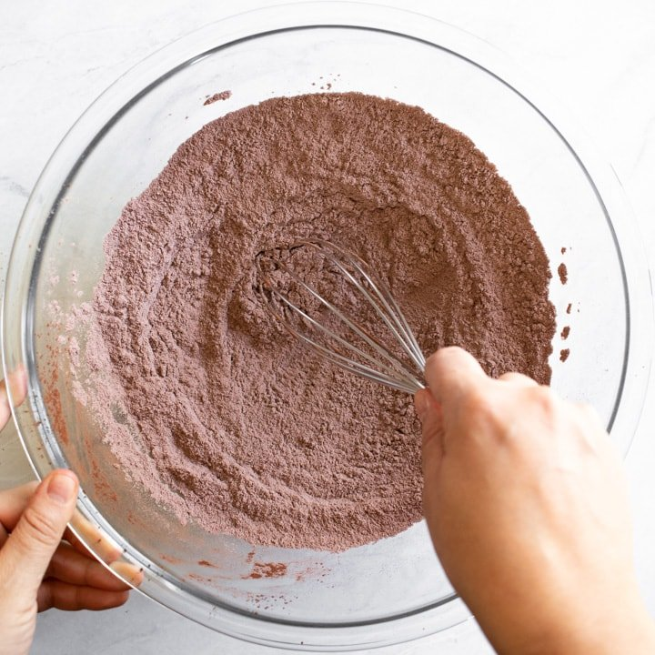 mixing dry ingredients for cocoa crinkle cookies