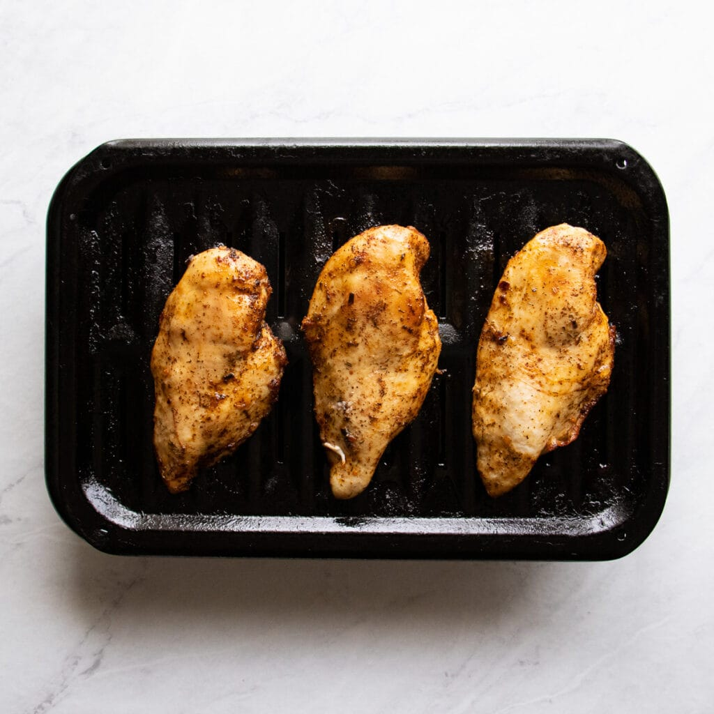 Cooked chicken on a broiler pan.