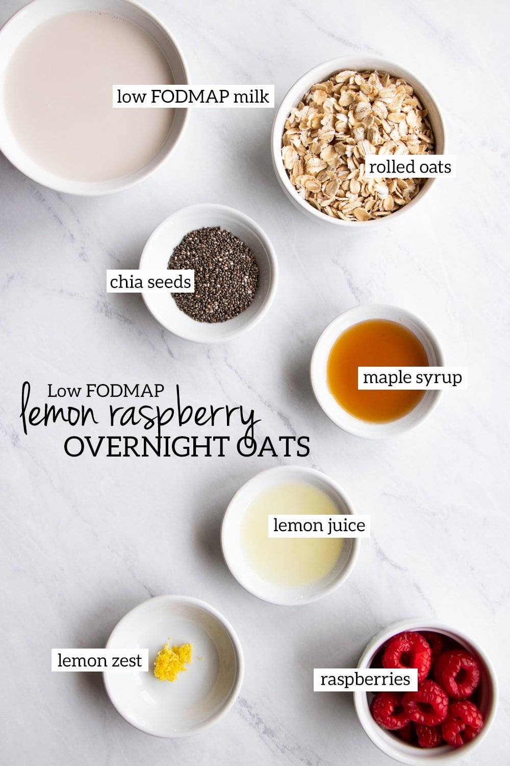 Ingredients needed for low FODMAP lemon-raspberry overnight oats measured out into individual white bowls.