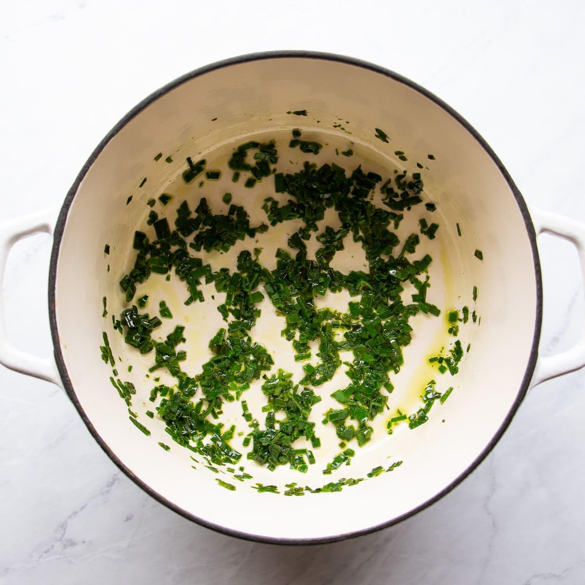 Step 1 - Saute the low FODMAP leek leaves in garlic-infused olive oil