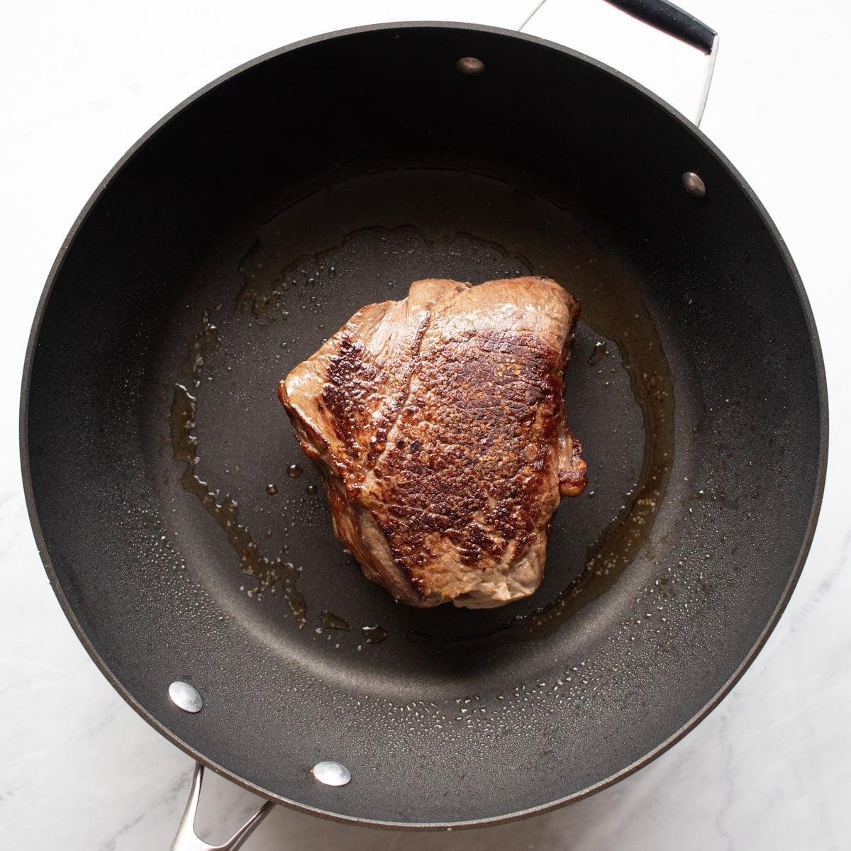 Seared beef roast in a skillet