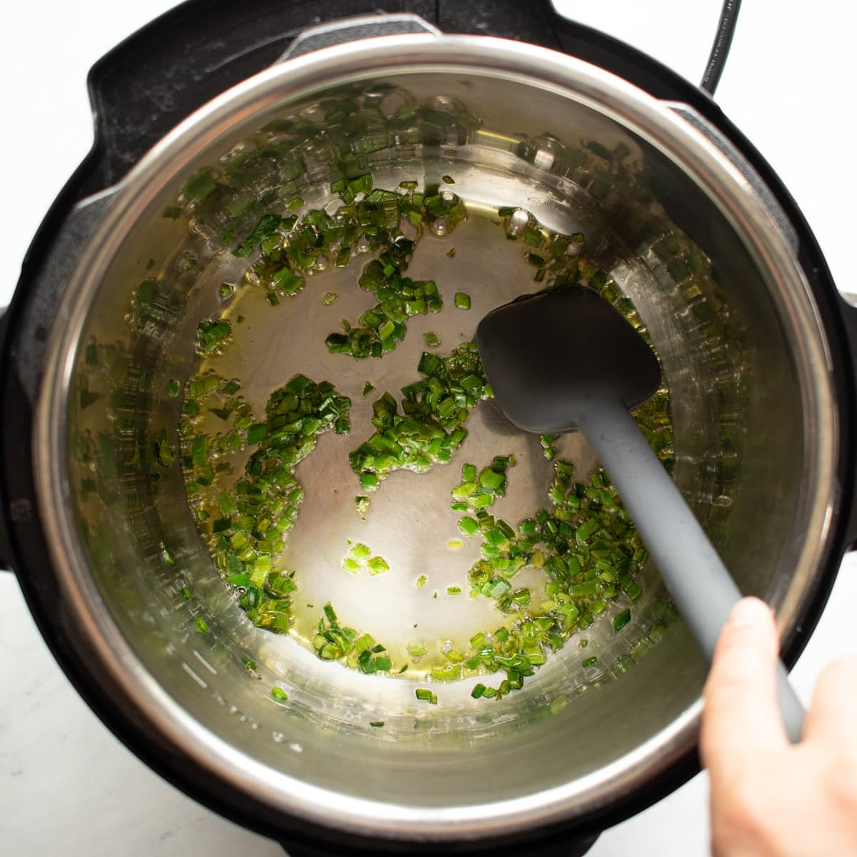 Sauteing chopped leek leaves in an Instant Pot