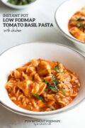 A white bowl filled with pasta tossed in a creamy tomato sauce. There's a sprinkle of fresh basil on top. In the white space behind the bowl a black text overlay reads Instant Pot Low FODMAP Tomato Basil Pasta with Chicken.
