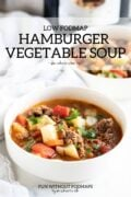 "Two bowls of hamburger veggie soup sit in front of a slow cooker. A text overlay reads ""Low FODMAP Hamburger Vegetable Soup"""