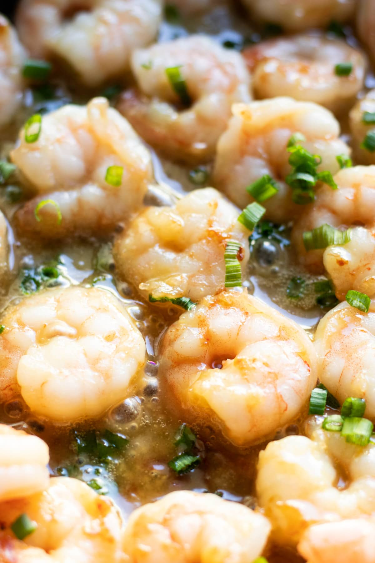 Close up of maple-mustard shrimp cooking in a skillet.