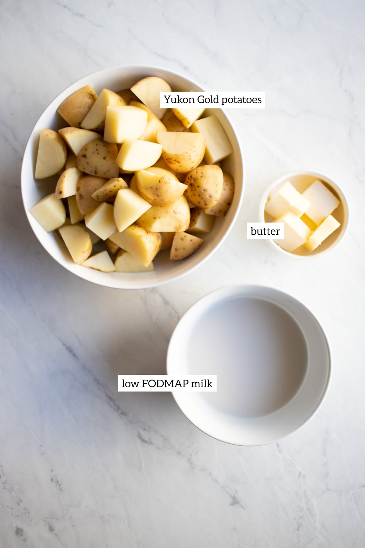 Ingredients needed to make low FODMAP mashed potatoes are measured out into individual dishes.