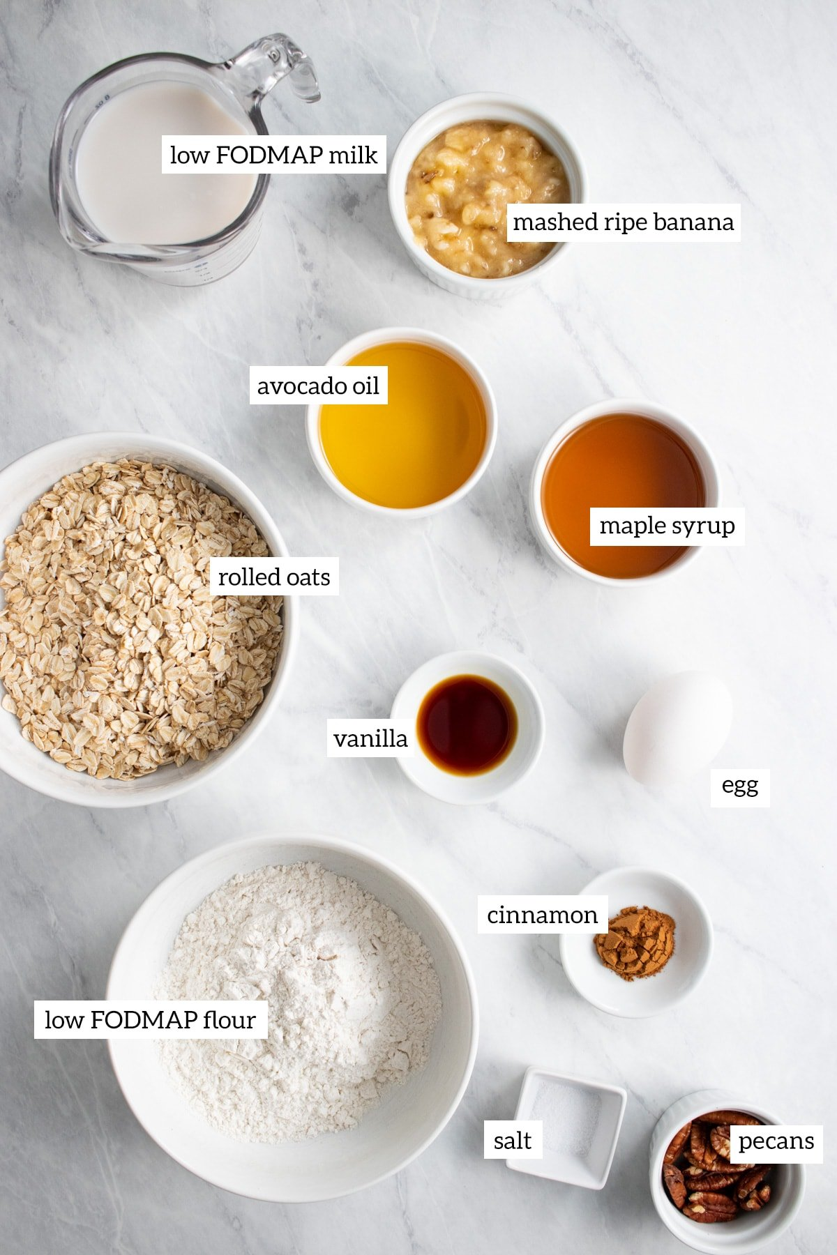 Ingredients needed to make baked oatmeal cups are measured out into individual white containers.