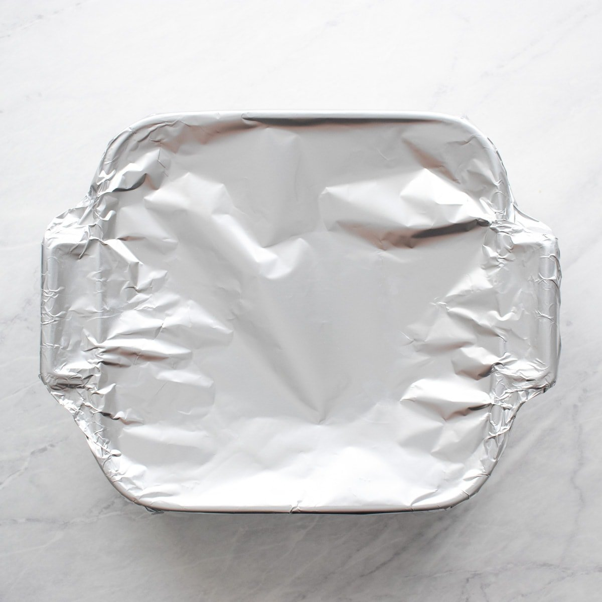 Baking dish covered with aluminum foil.