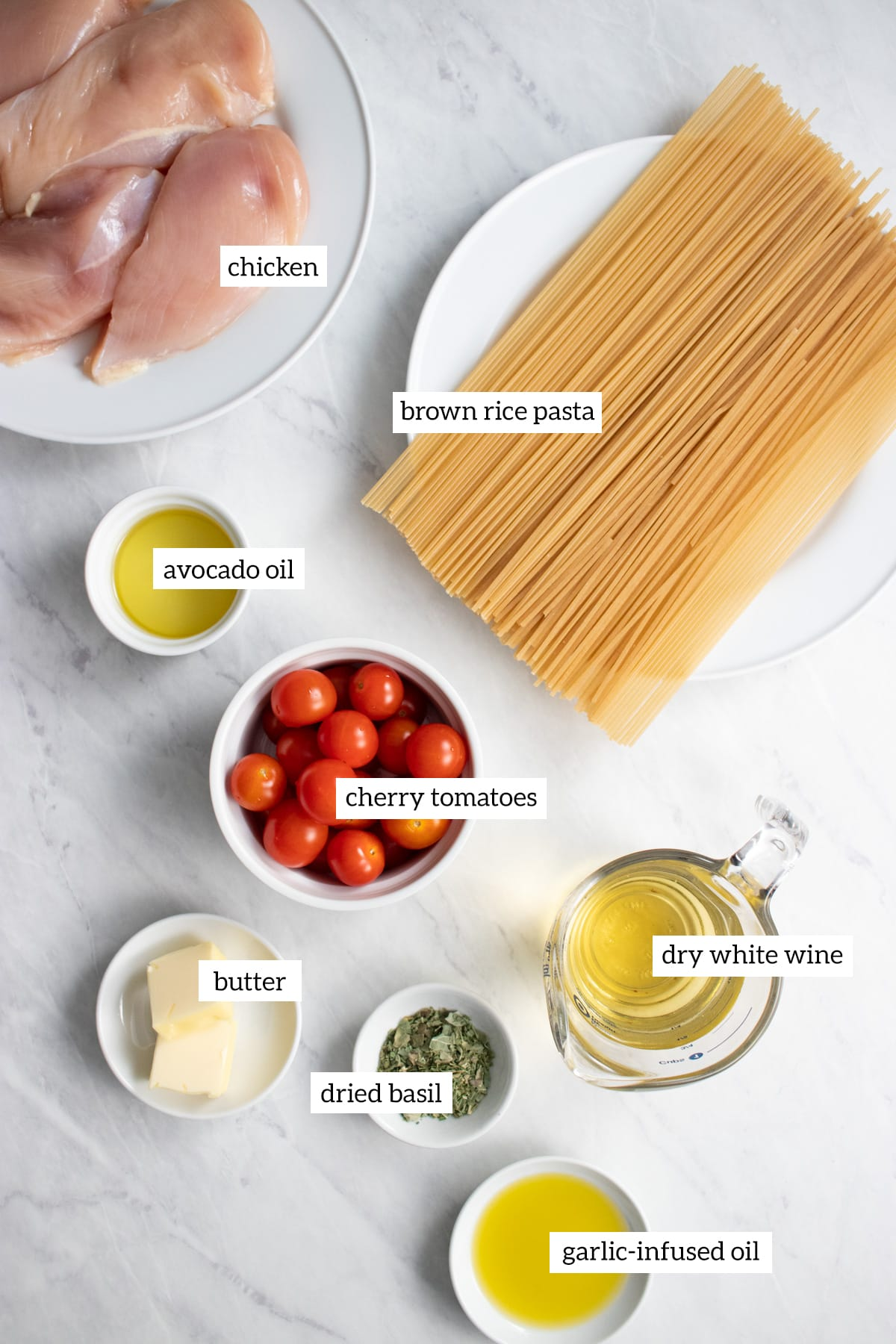 Ingredients needed for this low FODMAP spaghetti with chicken and cherry tomatoes recipe are measured out into individual containers.
