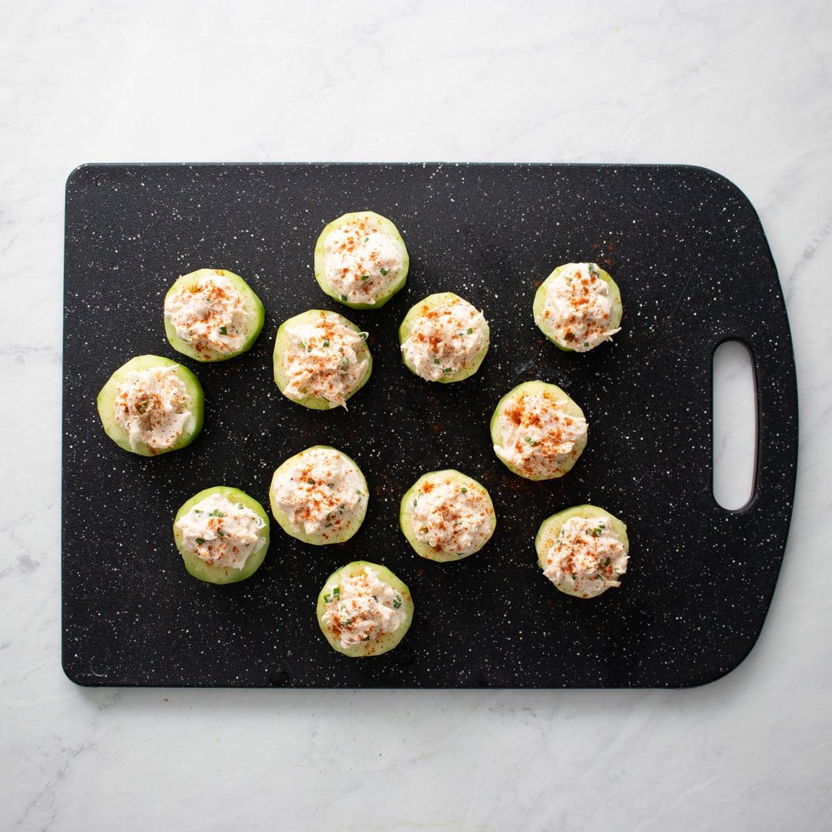 12 cucumber crab bites sprinkled with paprika